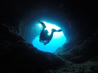 Underwater cave with diver